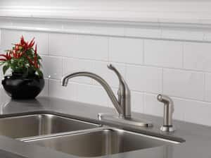 Delta Faucet Collins™ 1.8 gpm 3 or 4 Hole Deck Mount Kitchen Faucet with Single Lever Handle and Sidespray in White D440DST