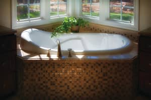 Hydro Systems Tribeca 67-1/2 x 35-1/2 in. Oval Whirlpool Bathtub with Thermal Air System and Center Drain in Biscuit HTRI6835MTABIS