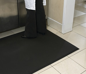 M+A Matting Complete Comfort™ 2 x 3 ft. x 0.625 in. Nitrile Carpet Protection with Holes in Black A49623 at Pollardwater