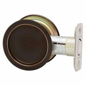Kwikset 2-12/25 x 2-12/25 in. Passage Round Pocket Door Lock in Oil Rubbed Bronze K33410BRNDPCKTDRLC